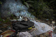 Clothes of a deceased COVID-19 victim lie in a cremation ground in Gauhati, India, Friday, July 2, 2021. The personal belongings of cremated COVID-19 victims lie strewn around the grounds of the Ulubari cremation ground in Gauhati, the biggest city in India's remote northeast. It's a fundamental change from the rites and traditions that surround death in the Hindu religion. And, perhaps, also reflects the grim fears grieving people shaken by the deaths of their loved ones — have of the virus in India, where more than 405,000 people have died. (AP Photo/Anupam Nath)
