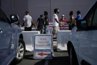 People wait in line at one of a few in person voting places during a nearly all-mail primary election Tuesday, June 9, 2020, in Las Vegas. (AP Photo/John Locher)