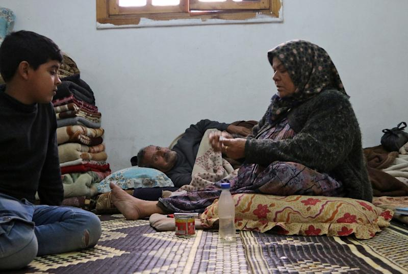 Amuna Hassan sits in an apartment in the Kurdish Syrian town of Afrin where her family is taking shelter with half a dozen other families after fleeing from a three-week assault by Turkey and allied Syrian rebels along the border (AFP Photo/Ahmad Shafie BILAL)