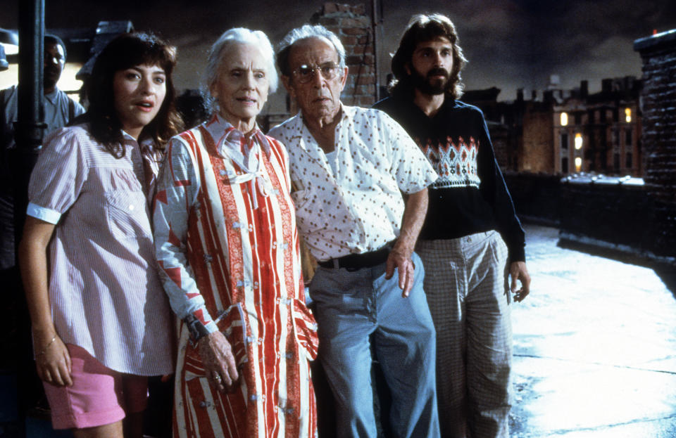 Frank McRae, Elizabeth Pe–a, Jessica Tandy, Hume Cronyn, and Dennis Boutsikaris standing out on roof in scene from the film '*Batteries Not Included', 1987. (Photo by Universal/Getty Images)