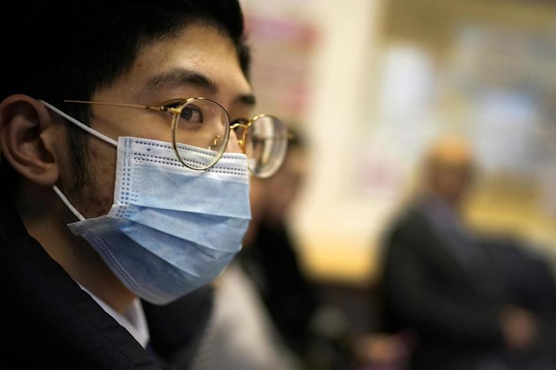 Members of the Manchester Chinese community take part in a discussion on the effects of coronavirus: Getty Images