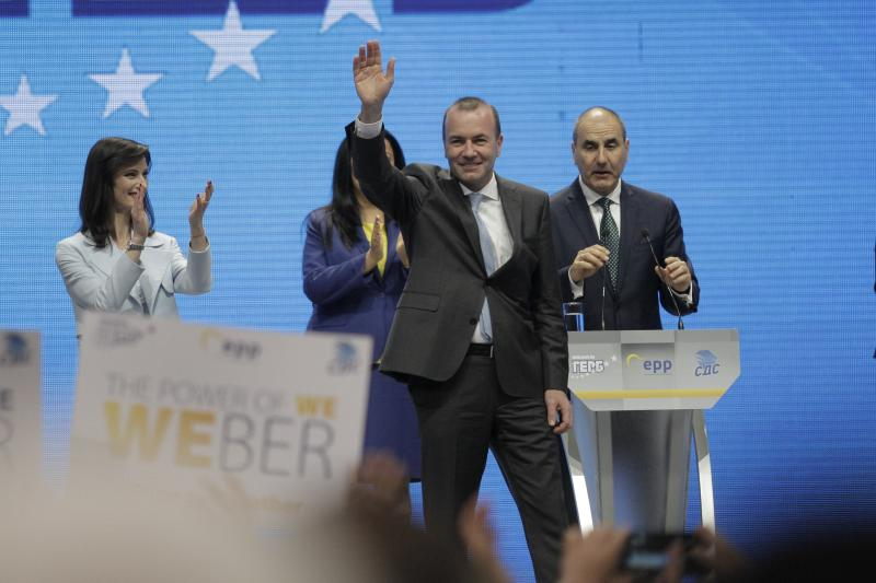 Germany's Manfred Weber of the European People's Party waves during ruling party GERB's rally in Sofia, Bulgaria, Sunday, May 19, 2019. The rally comes days before more than 400 million Europeans from 28 countries will head to the polls to choose lawmakers to represent them at the European Parliament for the next five years. (AP Photo/Valentina Petrova)