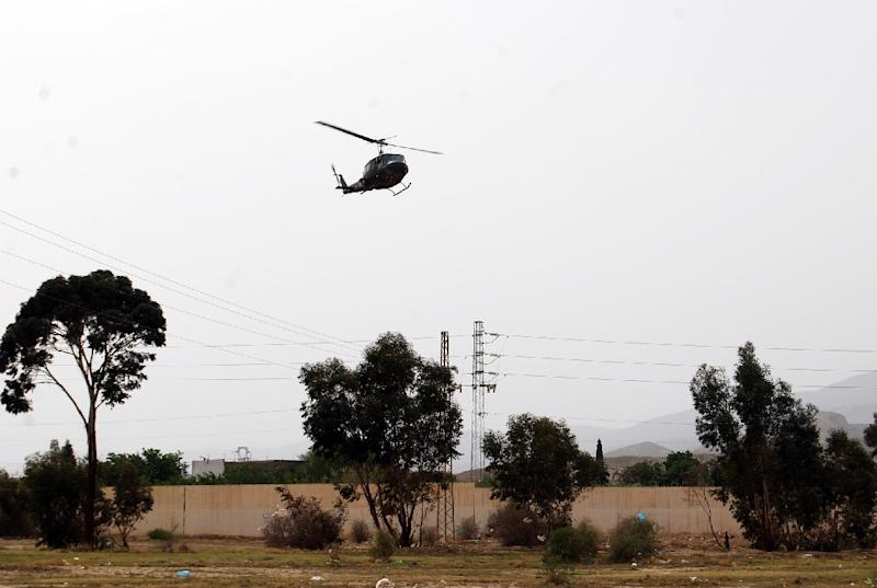 A Tunisian army helicopter patrols near the Mount Chaambi, a border region with Algeria