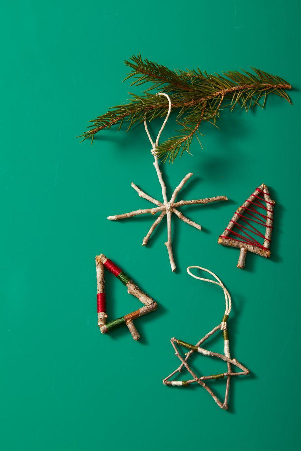 <p>Here's a fun one to do with kids: Use twigs, glue, and embroidery thread to DIY ornaments inspired by nature. </p>