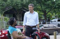 Beto O'Rourke, right, speaks with Stephanie Hanson before a canvassing drive by the Texas Organizing Project in West Dallas Wednesday, June 9, 2021. The former congressman and senatorial candidate is driving an effort to gather voter support to stop Texas' SB7 voting legislation. As politicians from Austin to Washington battle over how to run elections, many voters are disconnected from the fight. While both sides have a passionate base of voters intensely dialed in on the issue, a disengaged middle is baffled at the attention. (AP Photo/LM Otero)