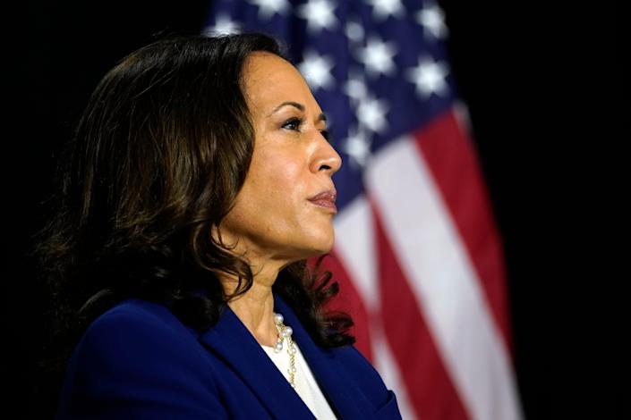 Sen. Kamala Harris, D-Calif., listens as Democratic presidential candidate former Vice President Joe Biden introduces her as his running mate at A.I. du Pont High School in Greenville on Wednesday, Aug. 12, 2020.