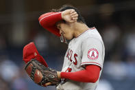 Los Angeles Angels pitcher Shohei Ohtani wipes his brow during the first inning of the team's baseball game against the New York Yankees on Wednesday, June 30, 2021, in New York. (AP Photo/Adam Hunger)