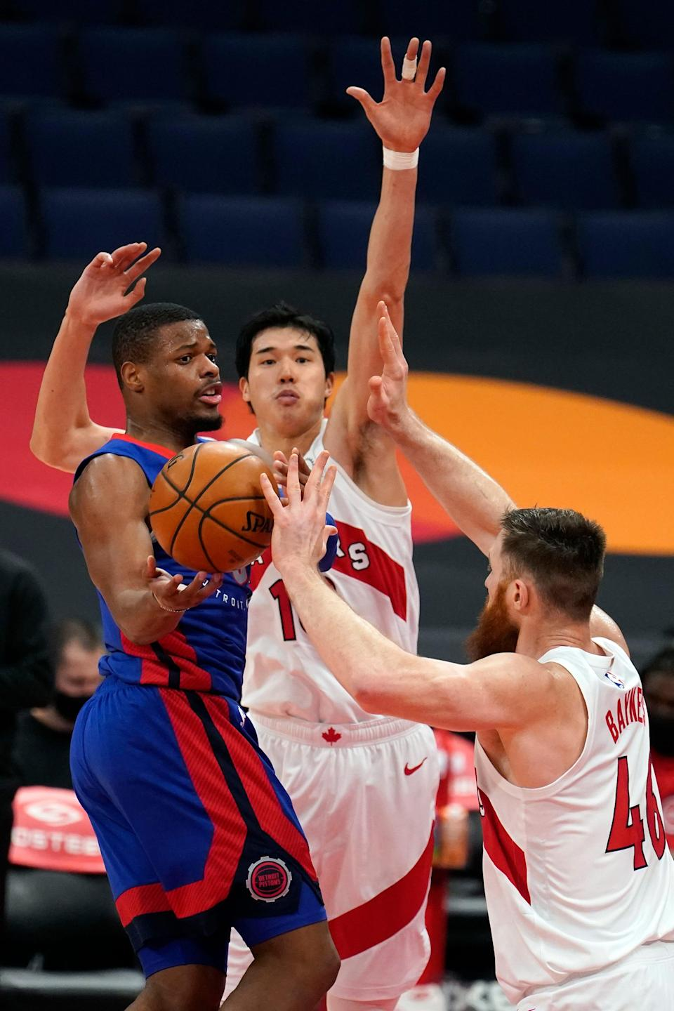 Pistons guard Dennis Smith Jr. loses the ball as he tries to get around Raptors forward Yuta Watanabe, center, and center Aron Baynes during the first half in Tampa, Florida, on Wednesday, March 3, 2021.
