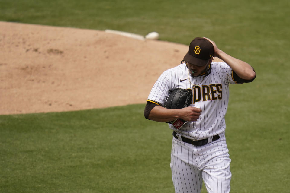 San Diego Padres starting pitcher Dinelson Lamet walks towards the dugout after the third out during the first inning of a baseball game against the Milwaukee Brewers, Wednesday, April 21, 2021, in San Diego. (AP Photo/Gregory Bull)