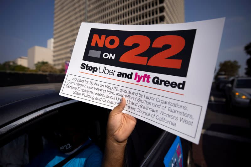 FILE PHOTO: App-based gig workers hold demonstration outside Los Angeles City Hall to urge voters to vote no on Proposition 22 in California
