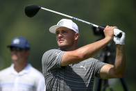 Bryson DeChambeau tees off on the fourth hole during the ProAm at the BMW Championship golf tournament, Wednesday, Aug. 25, 2021, at Caves Valley Golf Club in Owings Mills, Md. The BMW Championship tournament begins Thursday. (AP Photo/Nick Wass)