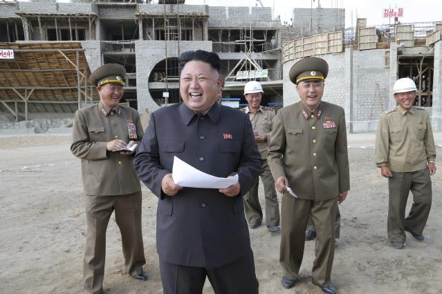 Kim Jong Un visits the construction sites of Pyongyang Baby Home and Orphanage in this undated photo released by North Korea's Korean Central News Agency (KCNA) in Pyongyang June 25, 2014. REUTERS/KCNA (NORTH KOREA - Tags: BUSINESS CONSTRUCTION POLITICS) ATTENTION EDITORS - THIS PICTURE WAS PROVIDED BY A THIRD PARTY. REUTERS IS UNABLE TO INDEPENDENTLY VERIFY THE AUTHENTICITY, CONTENT, LOCATION OR DATE OF THIS IMAGE. FOR EDITORIAL USE ONLY. NOT FOR SALE FOR MARKETING OR ADVERTISING CAMPAIGNS. THIS PICTURE IS DISTRIBUTED EXACTLY AS RECEIVED BY REUTERS, AS A SERVICE TO CLIENTS. NO THIRD PARTY SALES. NOT FOR USE BY REUTERS THIRD PARTY DISTRIBUTORS. SOUTH KOREA OUT. NO COMMERCIAL OR EDITORIAL SALES IN SOUTH KOREA