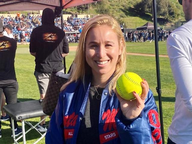 Carli Skaggs, wife of late Los Angeles Angels pitcher Tyler Skaggs, poses for a photo after throwing out the first pitch at the California Strong celebrity softball game in Malibu