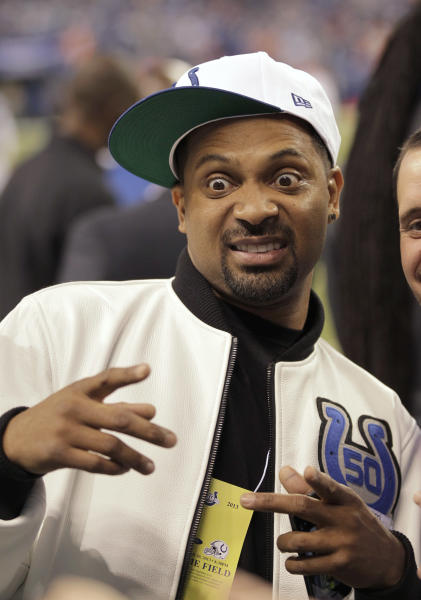 Actor Mike Epps poses for a picture on the sideline before an NFL football game between the Indianapolis Colts and the Denver Broncos, Sunday, Oct. 20, 2013, in Indianapolis. (AP Photo/AJ Mast)