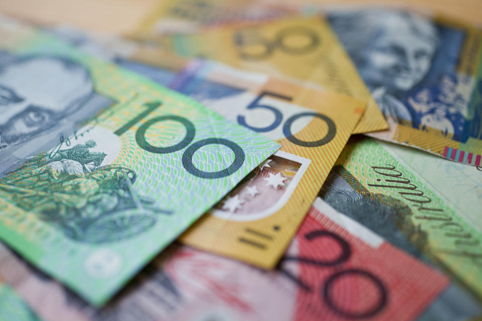 Australian money background showing $100, $50 and $20 notes with a shallow depth of field.