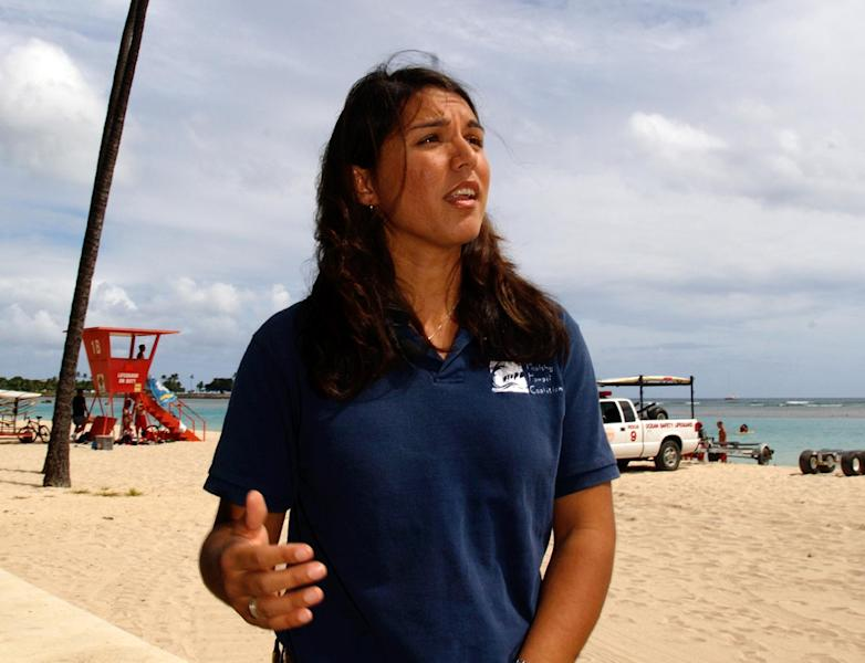 FILE - In this April 21, 2006 file photo, Tulsi Gabbard is seen on a beach near Waikiki in Honolulu. After more than a decade of wars in Iraq and Afghanistan, dozens of military veterans _ Republicans and Democrats _ are running for Congress this election year as voters have shown a fresh enthusiasm for candidates with no elected experience. This year, as the military has opened more jobs to women closer to the front lines, several of those veterans are females with battlefield scars and pioneering accomplishments. (AP Photo/Lucy Pemoni, File)