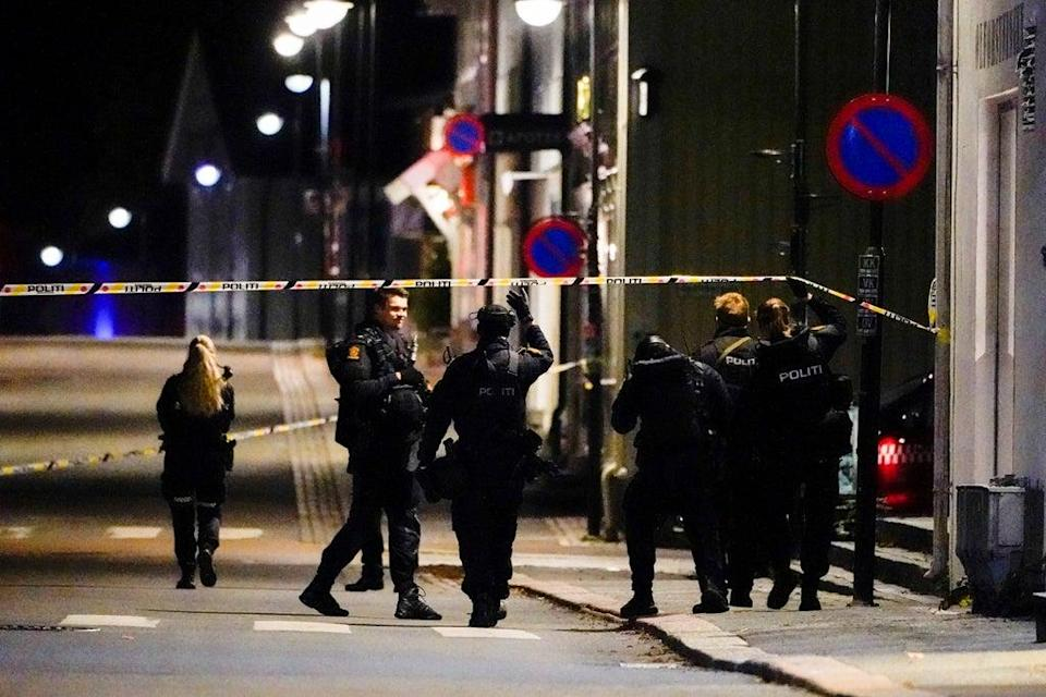 Police officers investigate after several people were killed and others were injured (via REUTERS)