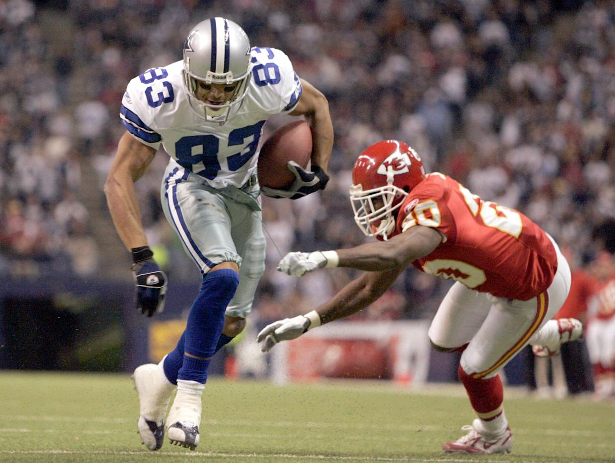 Dallas Cowboys' Terry Glenn advoids a tackle by Kansas City Chiefs corner back Benny Sapp on the way to a 6-yard touckdown run in Irving, Texas, on Sunday, Dec. 11, 2005. The Dallas Cowboys know that if they can get Terry Glenn involved, the offense will be productive.  (AP Photo/Donna McWilliam)
