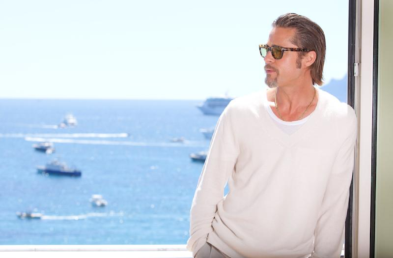 In this photo taken Tuesday, May 17, 2011, actor Brad Pitt poses for portraits after an interview with the Associated Press promoting the film The Tree of Life at the 64th international film festival, in Cannes, southern France, . (AP Photo/Joel Ryan)