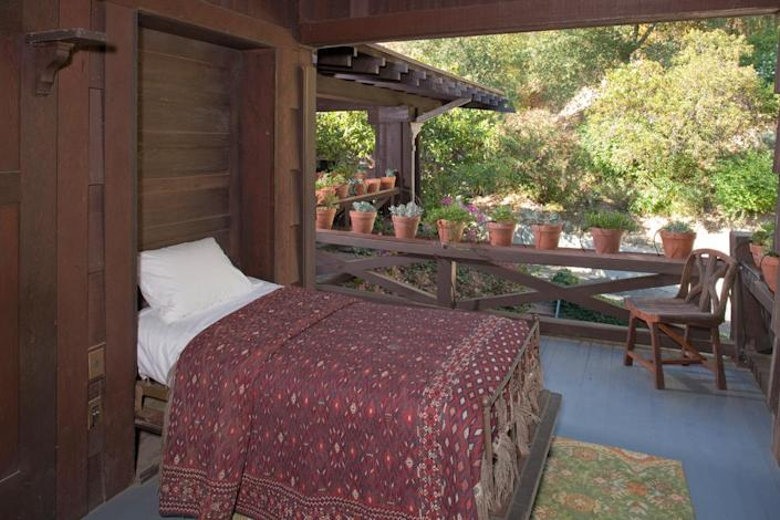 <p>And now a glimpse of the sleeping porch. There are five of these pull- down beds on the back porch of Artemesia's upper level.</p>