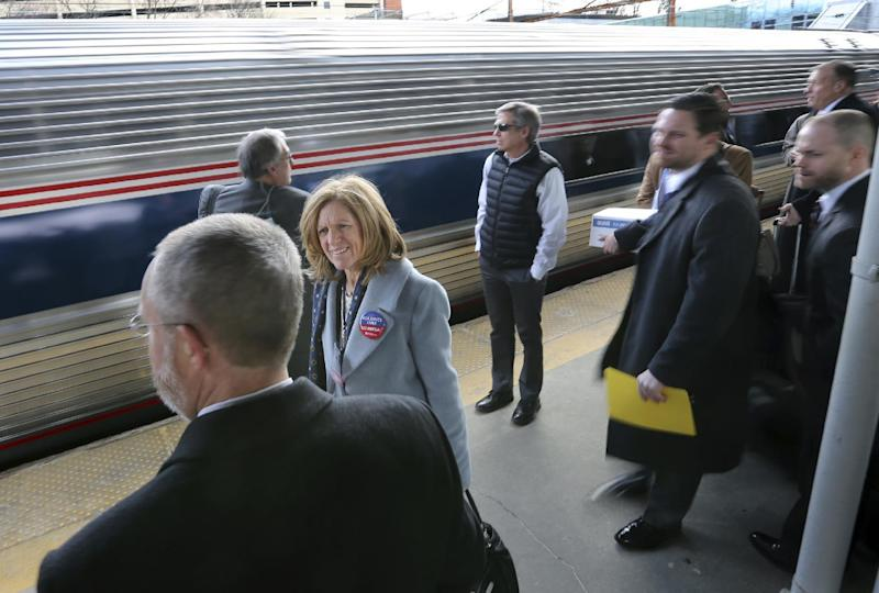"Some of the 1,000 lobbyists, business owners and politicians gather on a platform at the Trenton train station as a train arrives to take them to Washington, D.C., Thursday, Feb. 16, 2017, in Trenton, N.J. The state Chamber of Commerce's 80th annual trip — nicknamed the ""Walk to Washington"" because rail riders generally pace the train's corridors schmoozing and handing out business cards — comes after a national election that hinged in part on repudiating insiders and establishment politics. (AP Photo/Mel Evans)"