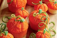 "Here's a fall project that's fun for kids: Make a cupcake pumpkin patch that boasts both standard and mini cupcakes. Each cupcake is a little different—just like in a real pumpkin patch. <a href=""https://www.epicurious.com/recipes/food/views/pumpkin-patch-cupcakes?mbid=synd_yahoo_rss"" rel=""nofollow noopener"" target=""_blank"" data-ylk=""slk:See recipe."" class=""link rapid-noclick-resp"">See recipe.</a>"