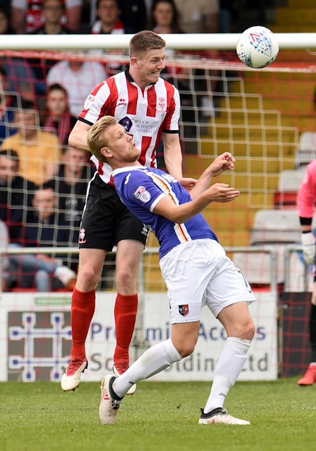 "Soccer Football - League Two Play Off Semi Final First Leg - Lincoln City v Exeter City - Sincil Bank, Lincoln, Britain - May 12, 2018 Lincoln city's Scott Wharton in action with Exeter City's Jayden Stockley Action Images/Paul Burrows EDITORIAL USE ONLY. No use with unauthorized audio, video, data, fixture lists, club/league logos or ""live"" services. Online in-match use limited to 75 images, no video emulation. No use in betting, games or single club/league/player publications. Please contact your account representative for further details."