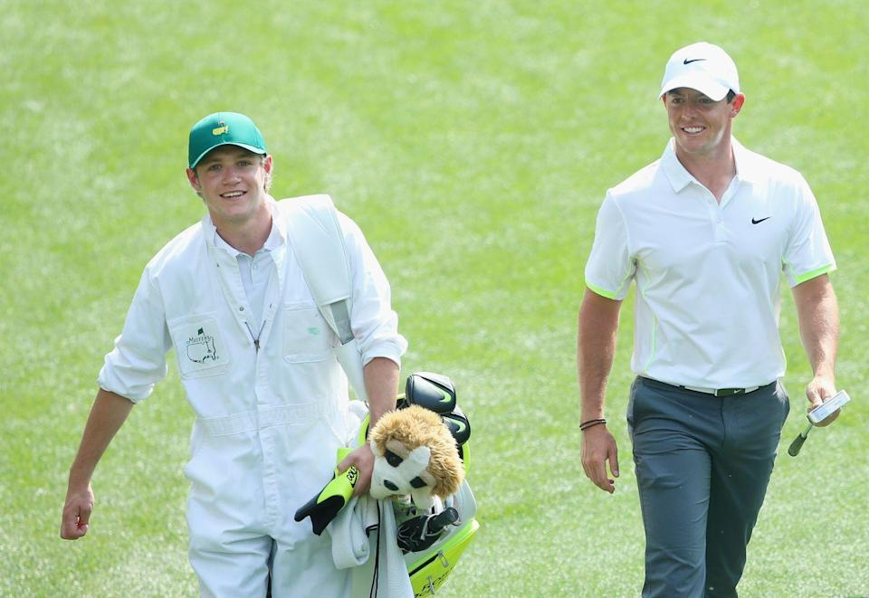<p>Rory McIlroy walks alongside his caddie, Niall Horan, during the Par 3 Contest prior to the start of the 2015 Masters Tournament.</p>