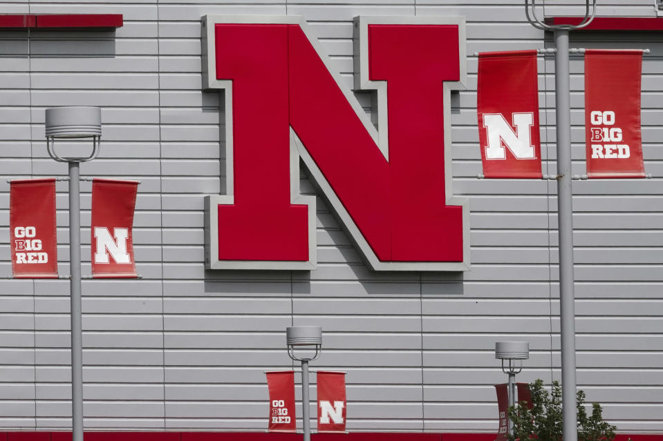 The Nebraska logo and flags incorporating the Big Ten logo are seen outside the Devaney sports center in Lincoln, Neb., Tuesday, Sept. 15, 2020. (AP Photo/Nati Harnik)