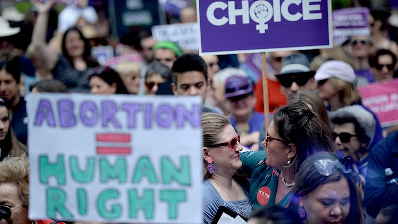 Abortion may be decriminalised in NSW if the bill passes in the lower house. A photo of an abortion rights rally.