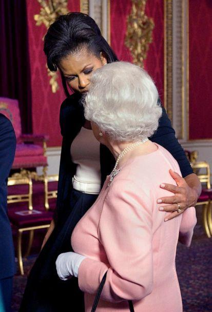 PHOTO: First lady Michelle Obama touches Britain's Queen Elizabeth II during a reception at Buckingham Palace in London, April 1, 2009. (Daniel Hambury/Pool via AP, FILE)