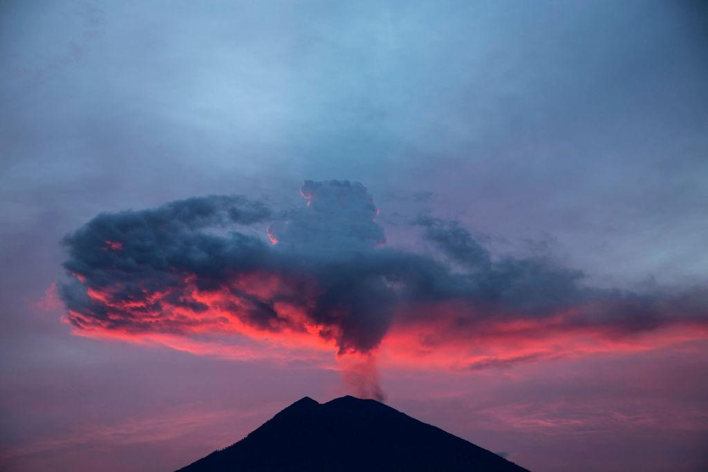 <p>View of Mount Agung in afternoon at Karang Asem – Bali. Mount Agung eruption a little bit cooling down, but still uncertain whethere the big explosion will happen or not. (Donal Husni/NurPhoto via Getty Images) </p>