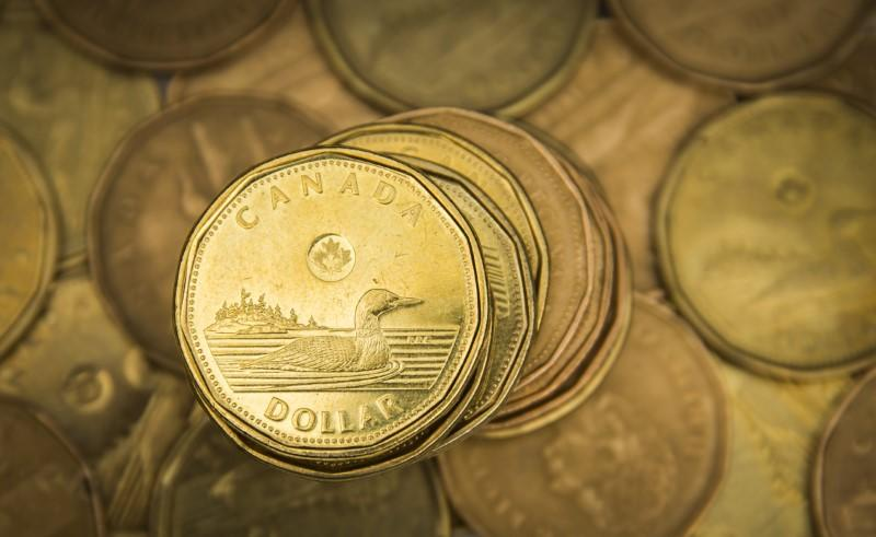 Canadian dollar surges to three-month high as investors unload the greenback