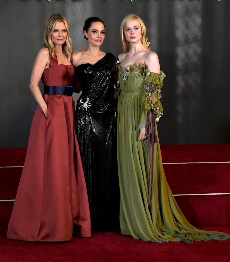 "(L-R) Michelle Pfeiffer, Angelina Jolie and Elle Fanning arrive at the premiere of Disney's ""Maleficent: Mistress Of Evil"" at the El Capitan Theatre on September 30, 2019 in Los Angeles, California. (Photo by Kevin Winter/Getty Images)"