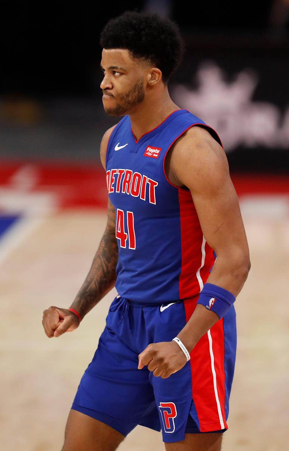 Detroit Pistons forward Saddiq Bey (41) pumps his fists during the fourth quarter against the Toronto Raptors at Little Caesars Arena on Wednesday, March 17, 2021.