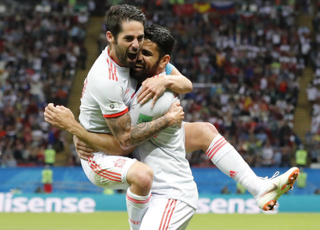 Spain's Diego Costa, right, celebrate after scoring his side's opening goal with Spain's Isco during the group B match between Iran and Spain at the 2018 soccer World Cup in the Kazan Arena in Kazan, Russia, Wednesday, June 20, 2018. (AP Photo/Frank Augstein)