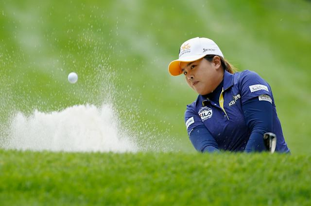 Park In-bee of South Korea plays a bunker shot on the 14th hole during the second round of the Wegmans LPGA Championship, at Monroe Golf Club in Pittsford, New York, on August 15, 2014 (AFP Photo/Scott Halleran)