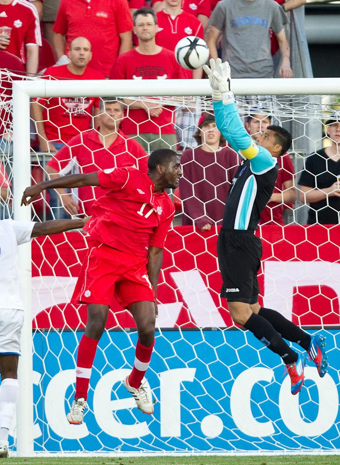 Olivier Occean of Canada (L) and Honduras' goal keeper Noel Valladares jump for the ball during their FIFA 2014 World Cup Qualifier at BMO field in Toronto, Ontario, June 12, 2012.  The match ended in a 0-0 tie.  AFP PHOTO / Geoff RobinsGEOFF ROBINS/AFP/GettyImages