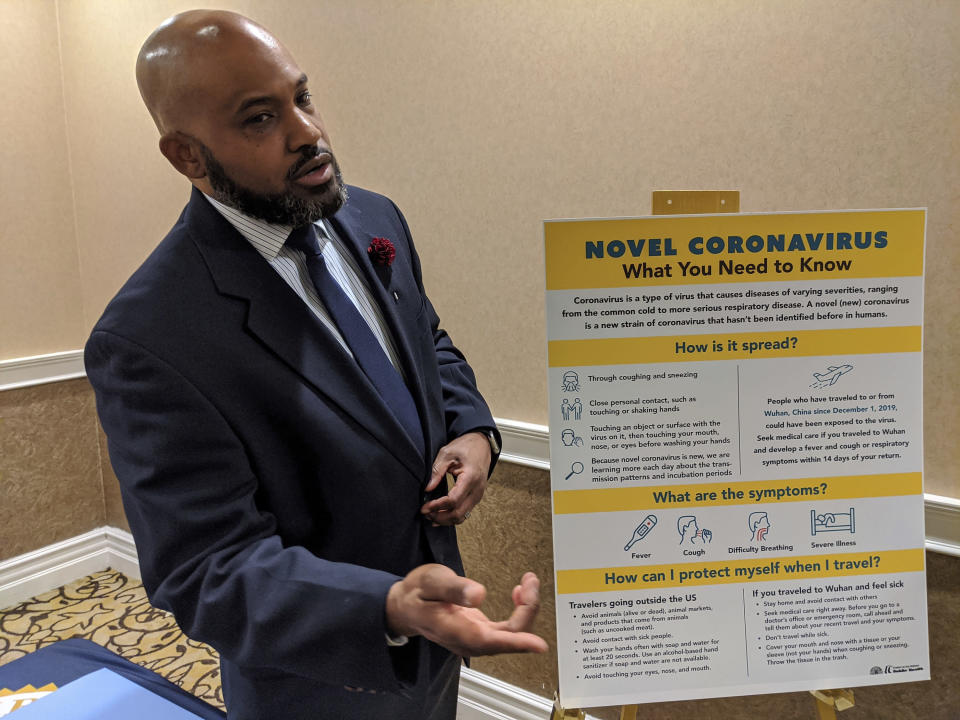 FILE - In this Friday, Jan. 31, 2020, file photo, Dr. Muntu Davis, MD, MPH, Los Angeles County Health Office, briefs the media on COVID-19 in San Gabriel, Calif., as the outbreak reaches Southern California. A rapid and sustained increase in COVID-19 cases in the nation's largest county requires restoring an indoor mask mandate even when people are vaccinated, Los Angeles County's public health officer said Thursday, July 14, 2021. Dr. Davis said at a virtual press conference that a public health order requiring masks indoors will go into effect Saturday, July 17. (AP Photo/Damian Dovarganes, File)