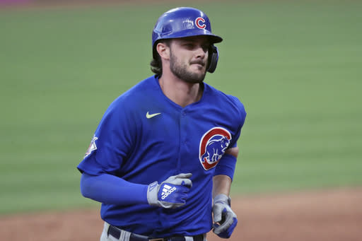 FILE - Chicago Cubs' Kris Bryant runs the bases after hitting a solo home run in the sixth inning during a baseball game against the Cleveland Indians in Cleveland, in this Wednesday, Aug. 12, 2020, file photo. Bryant is among roughly 125 players who entered Friday, Jan. 15, 2021, eligible to exchange salary arbitration figures with their teams. (AP Photo/Tony Dejak, File)