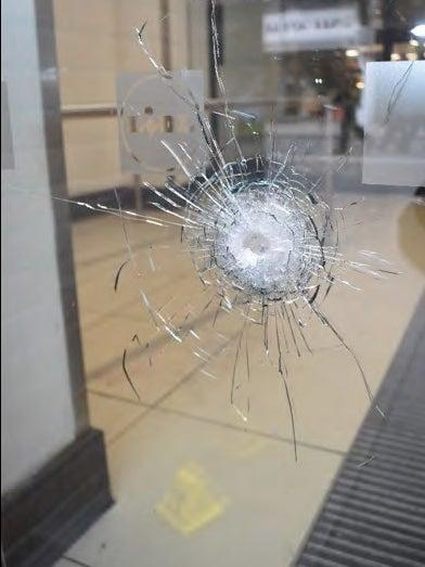 A bullet hole in the front of a Lidl supermarket in Streatham High Road after police opened fire at terrorist Sudesh Amman (Metropolitan Police)
