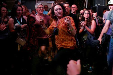 Mamak Khadem, who is Iranian-American, dances with the audience at the ContraBand Showcase featuring artists representing countries included in U.S. President Donald Trump's executive order travel bans, at the South by Southwest (SXSW) Music Film Interactive Festival 2017 in Austin, Texas, U.S. March 17, 2017.   REUTERS/Brian Snyder