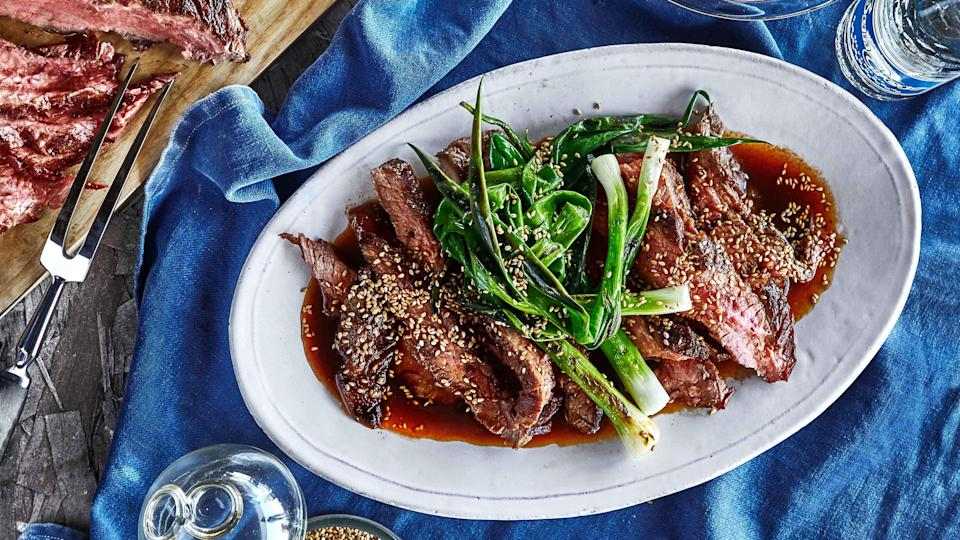 """We're flipping the script and <a href=""""https://www.epicurious.com/expert-advice/triple-dip-marinating-technique-article?mbid=synd_yahoo_rss"""" rel=""""nofollow noopener"""" target=""""_blank"""" data-ylk=""""slk:marinating after grilling"""" class=""""link rapid-noclick-resp"""">marinating after grilling</a>. In this case, the meat in question is flank steak, and the flavor comes from a spicy-sweet mixture of soy sauce, brown sugar, and Sriracha. You can marinate it up to an hour before serving. <a href=""""https://www.epicurious.com/recipes/food/views/soy-sauce-marinated-grilled-flank-steak-and-scallions?mbid=synd_yahoo_rss"""" rel=""""nofollow noopener"""" target=""""_blank"""" data-ylk=""""slk:See recipe."""" class=""""link rapid-noclick-resp"""">See recipe.</a>"""