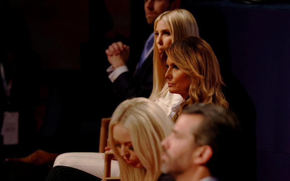 In Trump's corner: At the first debate in Cleveland, the president's guests, including the First Lady, were criticised for not wearing face masks - REUTERS
