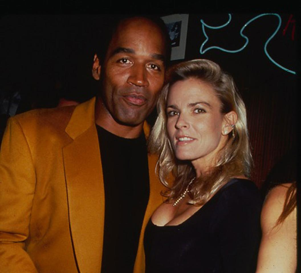 <p>Then, football star turned actor O.J. Simpson with his arm around his wife Nicole at the opening of the Harley Davidson Cafe on October 1, 1993 in New York City. (Photo: Rose Hartman/Getty Images) </p>