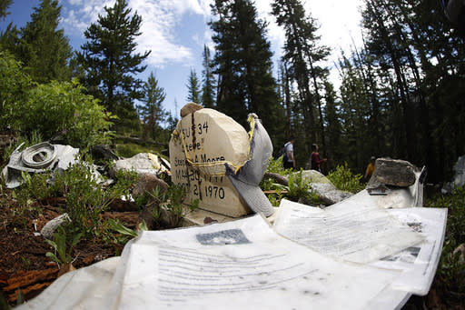 A memorial to Wichita State University Shockers player Stephen A. Moore stands at the site where an airplane that he was on crashed in 1970 as teammates, family members and friends visit the site near Loveland Pass Monday, July 27, 2020, west of Silver Plume, Colo. Wreckage from the plane, which was one of two being used to take the Shockers to play a football game against Utah State University in Logan, Utah, is still scattered on the mountain top nearly 50 years after the crash close to the Eisenhower Tunnel. (AP Photo/David Zalubowski)