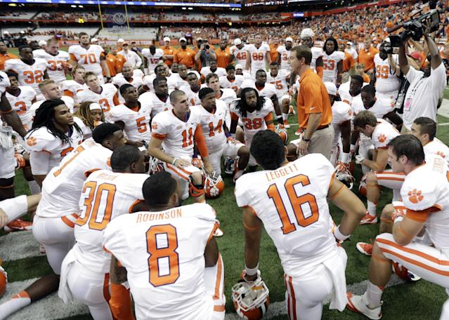 Clemson head coach Dabo Swinney, center right talks to his players before an NCAA college football game against Syracuse on Saturday, Oct. 5, 2013, in Syracuse, N.Y. (AP Photo/Mike Groll)