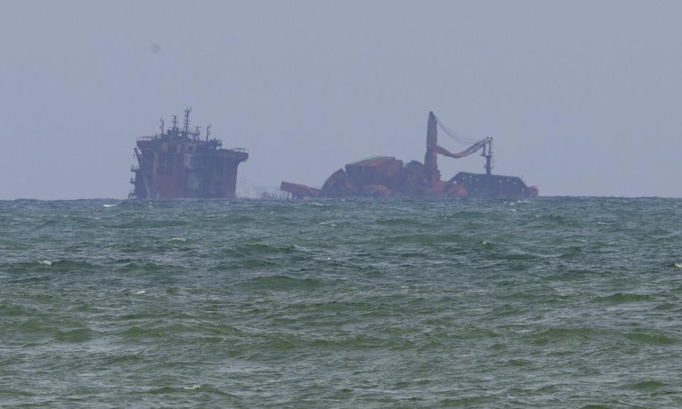 Fire-damaged container ship MV X-Press Pearl is seen partially sunk where it is anchored off Colombo port at Kapungoda, Sri Lanka, Friday, June 4, 2021. The Singapore-flagged ship started sinking Wednesday, a day after authorities extinguished a fire that raged on the vessel for 12 days. (AP Photo/Eranga Jayawardena)