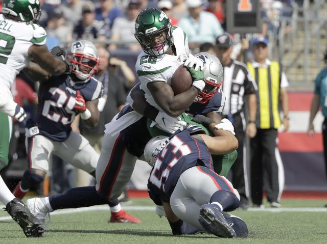 New England Patriots linebacker Ja'Whaun Bentley, rear, and New England Patriots linebacker Kyle Van Noy, front, tackle New York Jets running back Le'Veon Bell (26) in the first half of an NFL football game, Sunday, Sept. 22, 2019, in Foxborough, Mass. (AP Photo/Steven Senne)