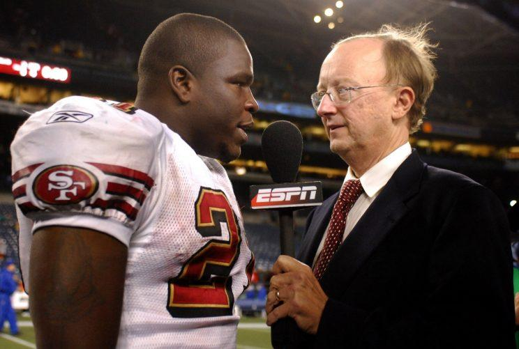 John Clayton talks to 49ers running back Frank Gore after a 2006 game. (AP)